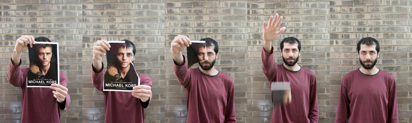 retrato de un chico con una hoja de revista delante de su cara. conforme se va eliminando la revista, va apareciendo su rostro.